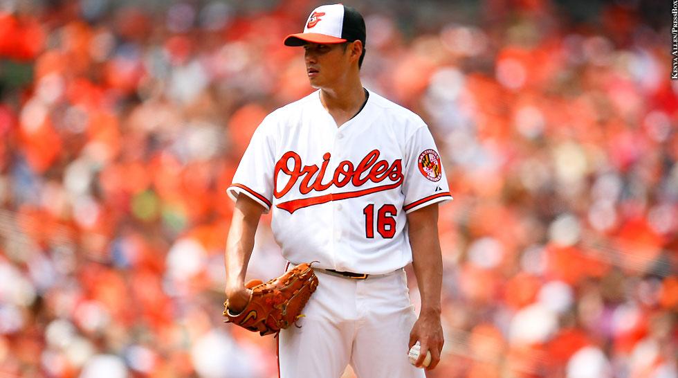 Orioles 2015: Wei-Yin Chen (white jersey, holding baseball)