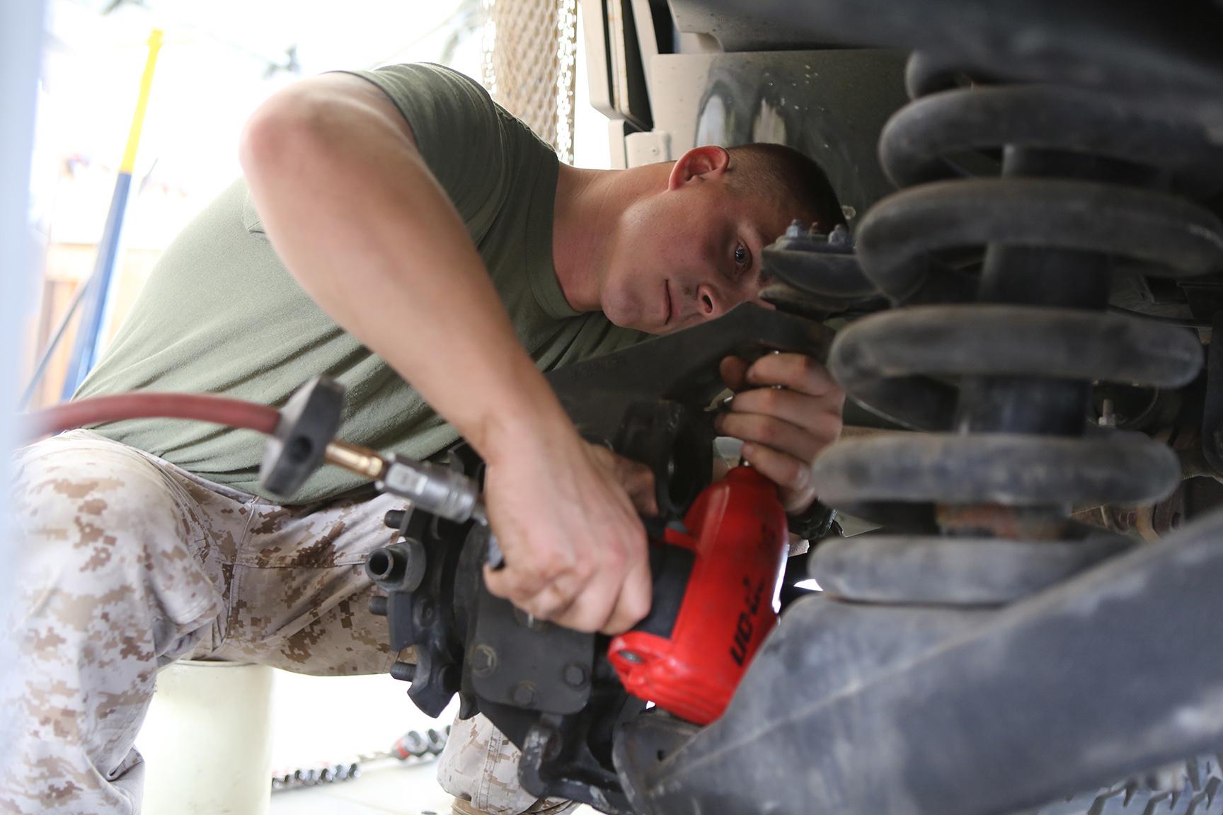 pog vs grunt marine 11th meu marines work on humvee