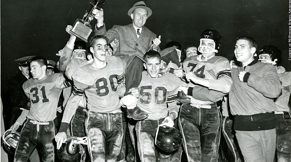 Issue 214: Gilman vs. McDonogh: Coach Dick Working is carried from the field after McDonogh beats Gilman, 46-0, in 1959.