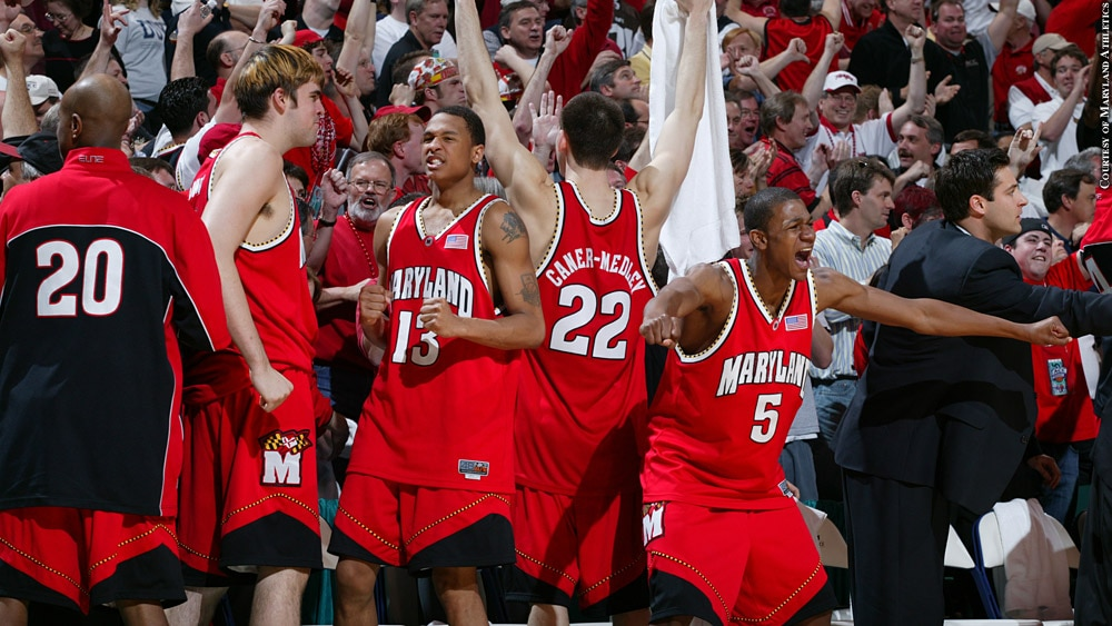 Issue 252: 2004 ACC Tournament: Maryland Terps Basketball: D.J. Strawberry and teammates celebrate