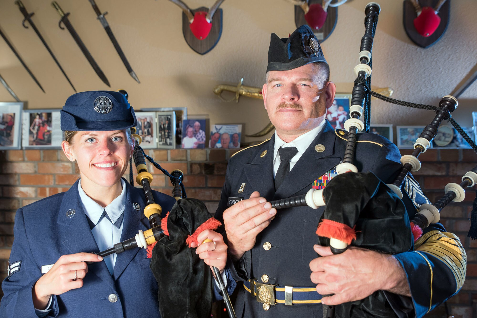 Air Guard Senior Airman Mariah Connell and her father, Sgt. 1st Class Michael Connell