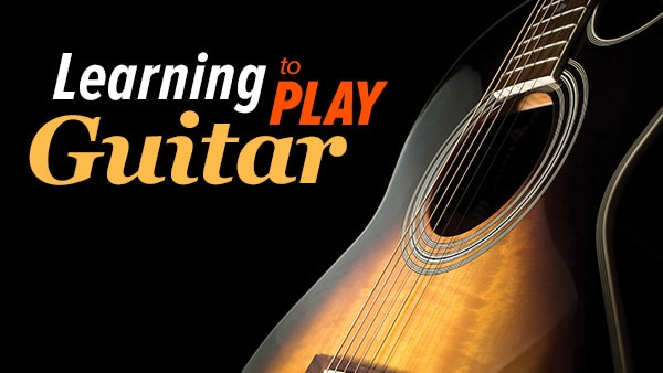 learning to play guitar  chords  scales  and solos