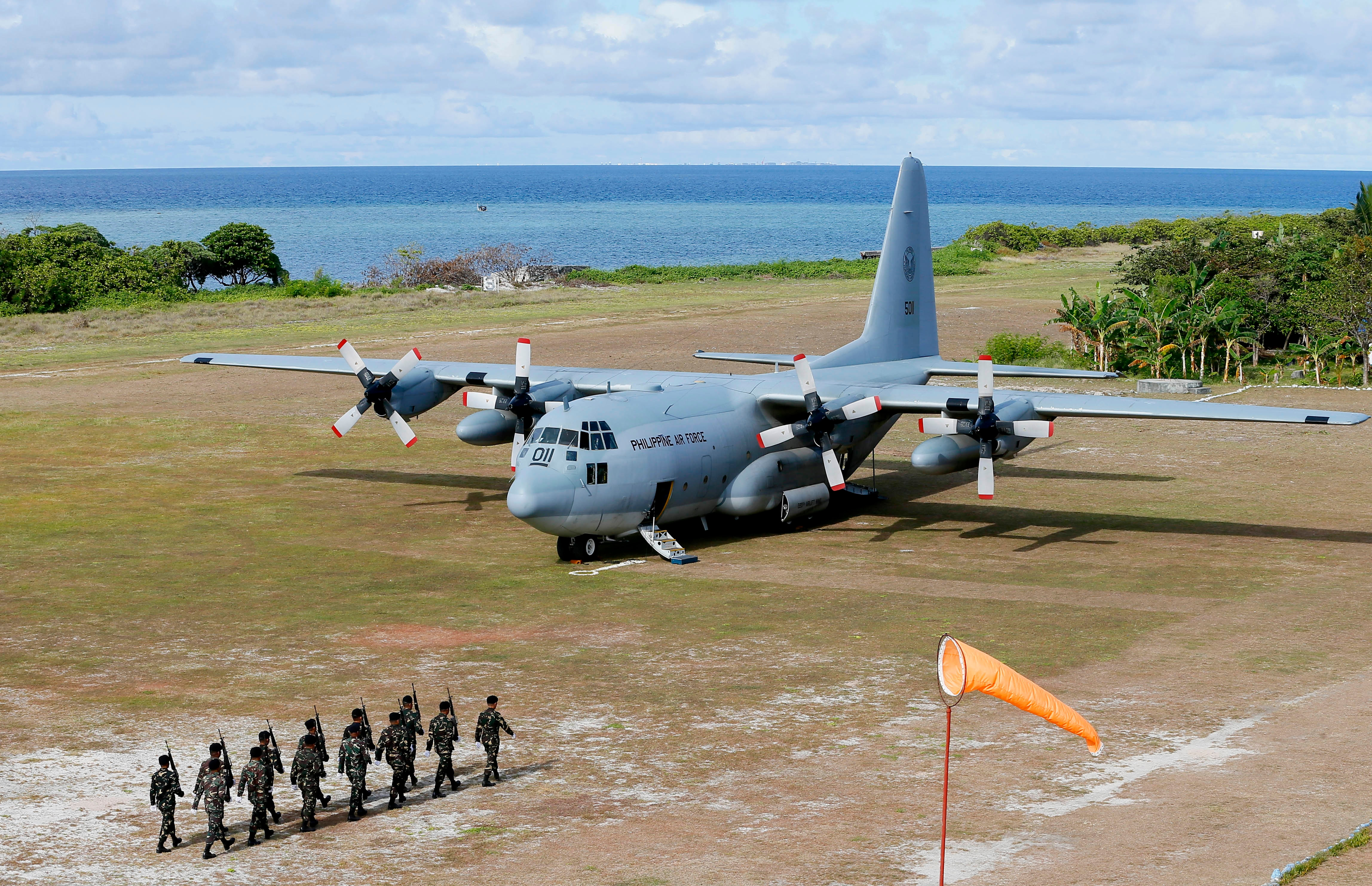 Defense chief on Philippine-occupied island in disputed seas