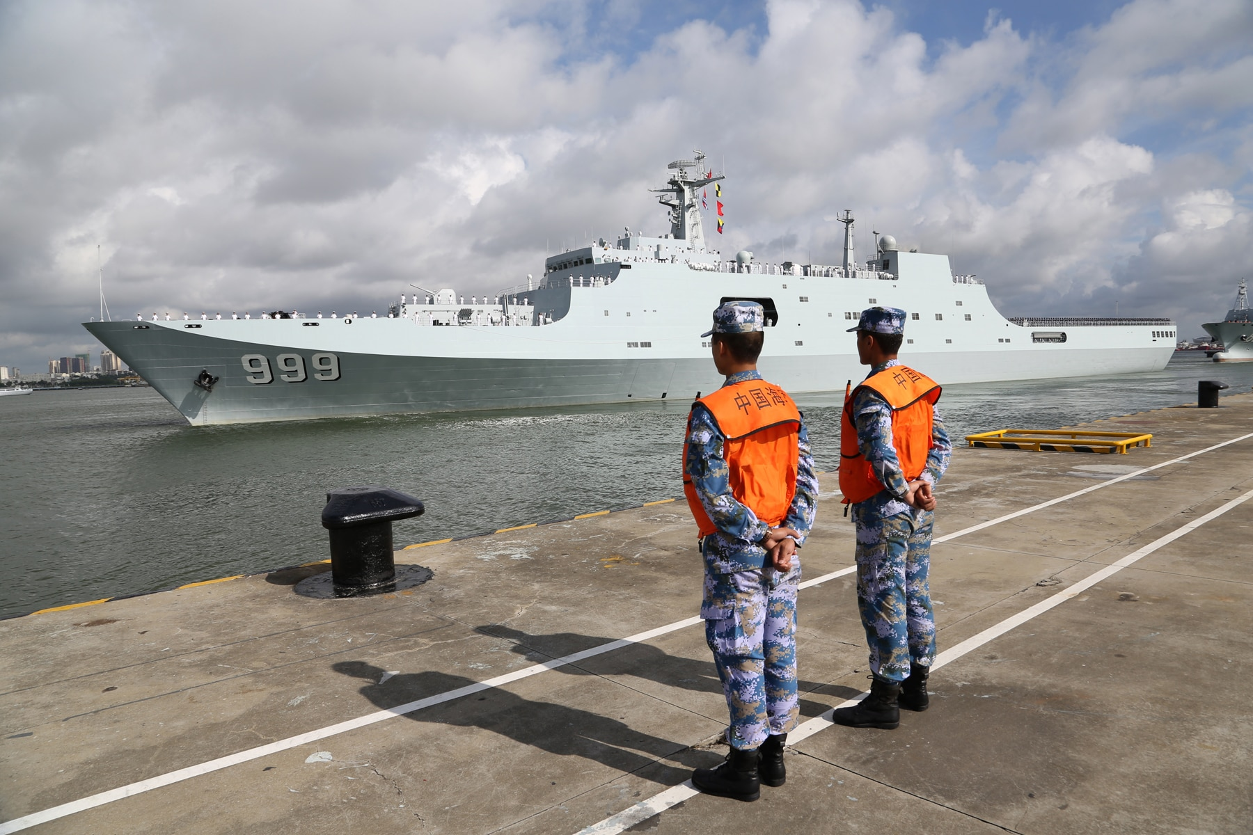 Chinese military personnel departs a port in Zhanjiang