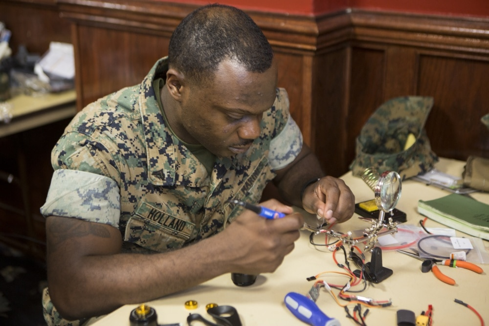U.S. Marines with II Marine Expeditionary Force assemble the Nibbler drone.