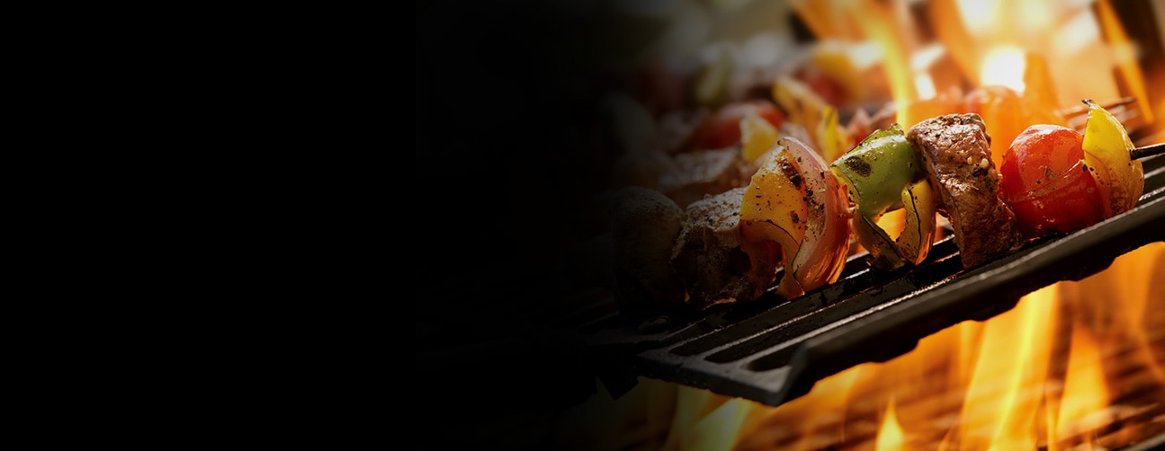Image of Kebab on open flame grill