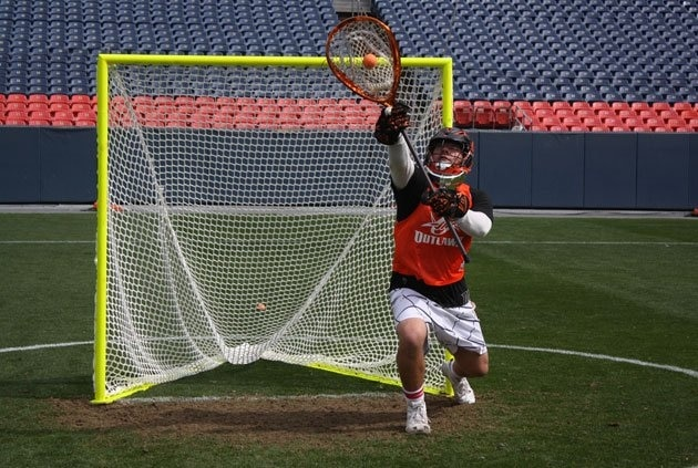 Goalie Jessie Schwartzman makes a save during the Outlaws' 2011 Training Camp